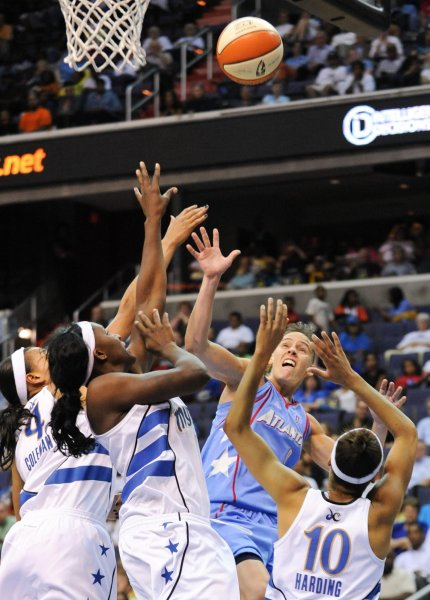 Atlanta Dream Coco Miller (9) is surrounded by Washington Mystics players as she tries to grab a rebound during the third quarter of game 1 of the Eastern Conference Semi-Finals at the Verizon Center in Washington on August 25, 2010. The Dream beat the Mystics 95-90. UPI/Alexis C. Glenn