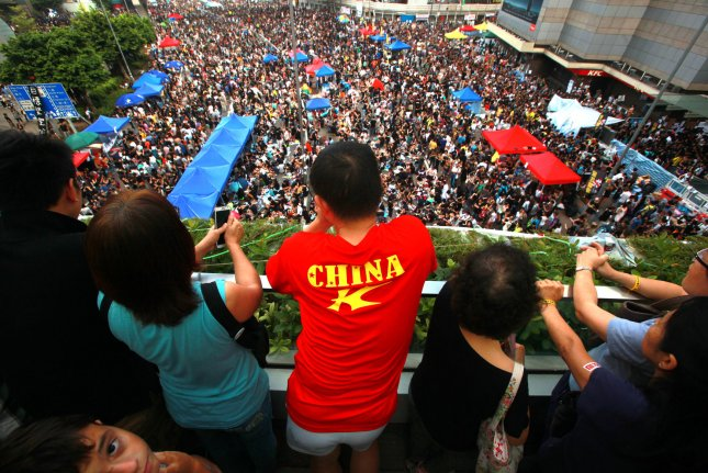 Pro-democracy activists shut down parts of downtown Hong Kong on Oct. 1. File Photo by Stephen Shaver/UPI