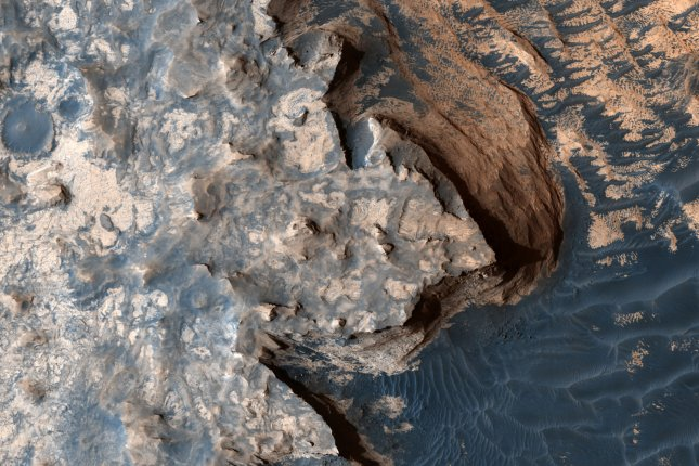 New research suggests outflows of methane could have warned Mars' atmosphere and melted water ice a few billion years ago, allowing lakes and rivers to flow through Martian craters. Photo by NASA/UPI