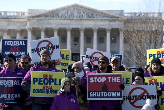 Members and supporters of the National Air Controllers Association and other aviation industry associations protest the partial federal government shutdown at the U.S. Capitol on Thursday. In two polls, a majority of Americans blame President Donald Trump for the shutdown. Photo by Kevin Dietsch/UPI
