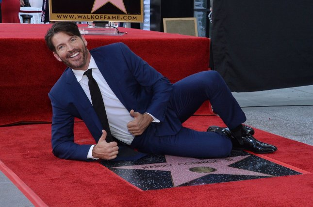 Grammy- and Emmy-winning singer, composer, actor and television host Harry Connick Jr. lies beside his star during an unveiling ceremony honoring him with the 2,678th star on the Hollywood Walk of Fame in Los Angeles on Thursday. Photo by Jim Ruymen/UPI