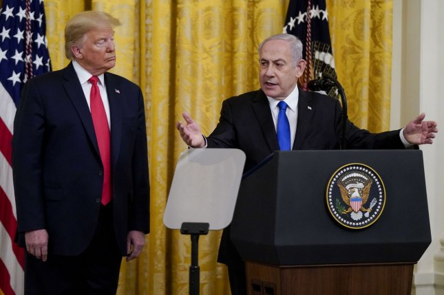 President Donald Trump (L) and Israeli Prime Minister  Benjamin Netanyahu discuss a plan for Middle East peace in the East Room of the the White House on Tuesday.  Photo by Leigh Vogel/UPI