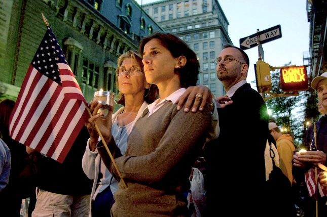 While the remembrances and tributes to those lost in the terrorist attacks of September 11, 2001, are meant to offer solace and solidarity, some people can be retraumatized by images and video of the day, including those who lost friends and family in the attacks. File Photo by Chris Corder/UPI