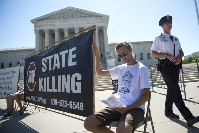 Death penalty opponents demonstrate outside of the U.S. Supreme Court on June 29, 2015 in Washington, D.C. The high court ruled on the controversial execution drug that was used in a botched execution, congressional redistricting and Environmental Protection Agency limits on the emission of mercury and other toxic pollutants from power plants. Photo by Kevin Dietsch/UPI.