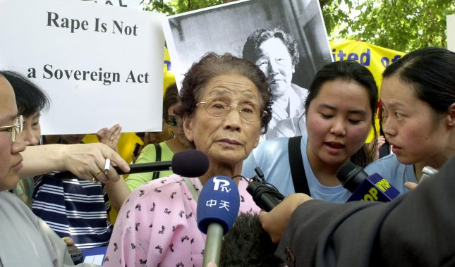 Kim Soon-Duk, a survivor of World War II sexual slavery in Japan and China, speaks at a rally sponsored by The National Organization for Women outside the U.S. State Department in Washington, July 23, 2001. The rally was held by demonstrators seeking justice for former comfort women. Wednesday the South Korean Foreign Ministry announced a $9.5 million deposit from the Japanese government to a foundation dedicated to commemorating the women and helping survivors. Photo by Jennifer Bowman/UPI