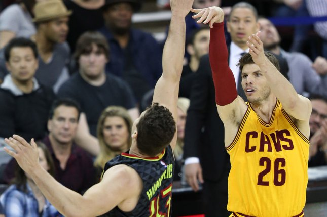 Cleveland Cavaliers' Kyle Korver hits a three-point shot over Atlanta Hawks defender Kris Humphries during the second half at Quicken Loans Arena in Cleveland on April 7, 2017. File photo by Aaron Josefczyk/UPI