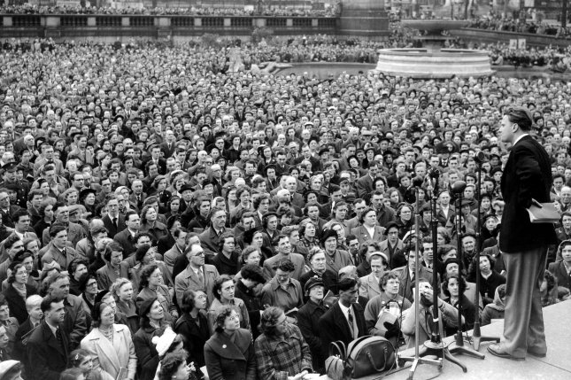 Evangelist Billy Graham addresses a crowd in Trafalgar Square on April 5, 1954, during an extended preaching visit in Britain. UPI Photo/File