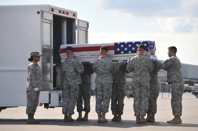 An Army Transfer Unit moves the transfer case containing the remains of Army Sgt. Brandon Maggart, of Kirksville, Mo., at Dover Air Force Base in Delaware, Aug. 23, 2010. Maggart was killed during Operation Iraqi Freedom. UPI/Kevin Dietsch.