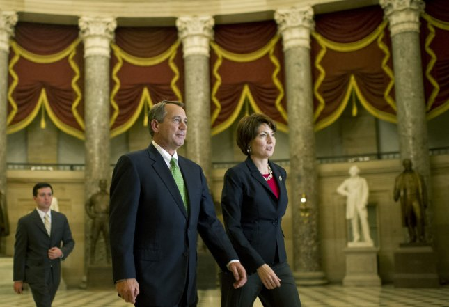 Speaker of the House John Boehner and Rep. Cathy McMorris Rodgers (R-WA) walk to the House chambers to vote on the Senate's Fiscal Cliff deal legislation on Capitol Hill in Washington, DC on January 1, 2013. The legislation passed 257-167. UPI/Kevin Dietsch