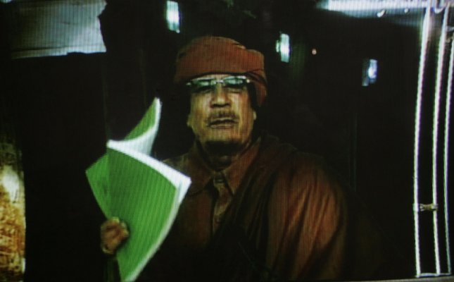An image taken from footage broadcast on Libyan state television on February 22, 2011 shows Libyan leader Moammer Gadhafi gesturing while delivering a nationwide address in Tripoli. Kadhafi says he will stay in Libya despite the bloody showdown between protesters and his security forces. UPI/Ismael Mohamad