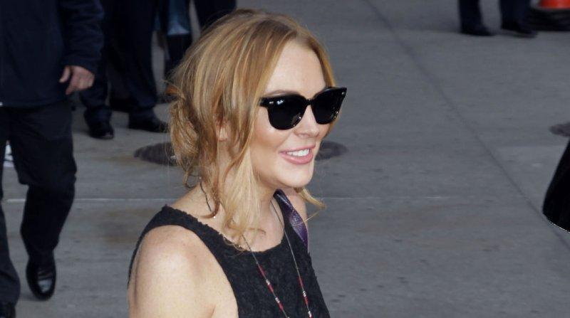 Lindsay Lohan exits from the David Letterman Show at The Ed Sullivan Theater in New York City on April 9, 2013. UPI/John Angelillo