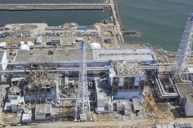 The crippled Fukushima Daiichi nuclear power plant in Okumamachi, Fukushima prefecture, northern Japan is seen in this March 24, 2011 aerial photo taken by small unmanned drone and released by AIR PHOTO SERVICE. (UPI/Air Photo Service Co. Ltd.)
