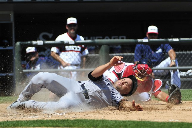 New York Yankees' Carlos Beltran (L) is safe at home as Chicago White Sox catcher Geovany Soto (58) makes a late tag during the fourth inning at U.S. Cellular Field on August 2, 2015 in Chicago. Photo by David Banks/UPI