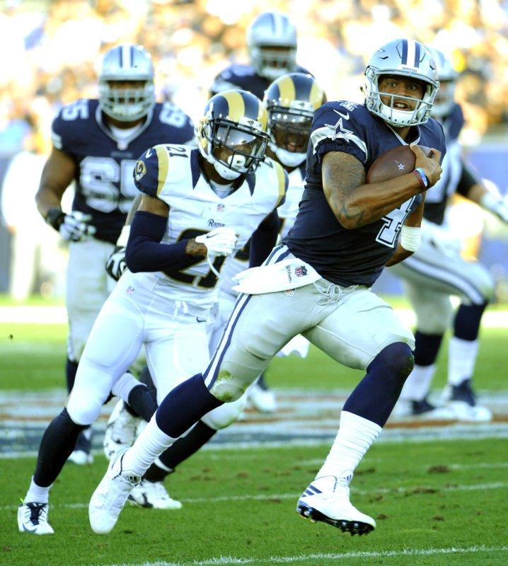 Dallas Cowboys backup quarterback Dak Prescott runs the ball for a gain against the Los Angeles Rams in the second quarter of a preseason game at Los Angeles Coliseum on Saturday. Photo by Lori Shepler/UPI