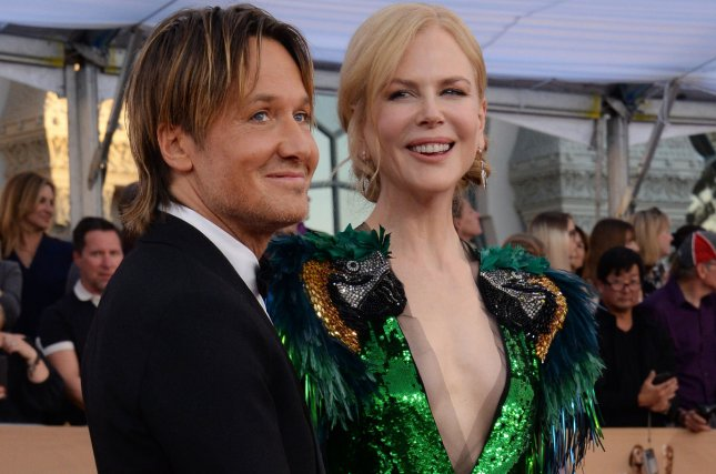 Musician Keith Urban (L) and actress Nicole Kidman arrive for the the 23rd annual SAG Awards held at the Shrine Auditorium in Los Angeles on January 29. Urban was nominated for seven ACM Awards on Thursday. Photo by Jim Ruymen/UPI