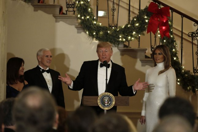 U.S. President Donald Trump speaks between first lady Melania Trump and Vice President Mike Pence with his wife Karen Pence at the Congressional Ball at White House on Saturday night. Photo by Yuri Gripas/UPI