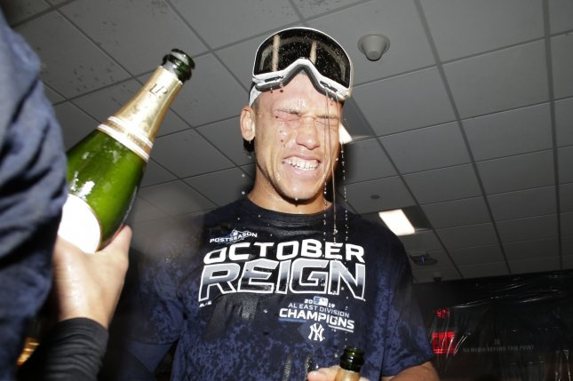 New York Yankees slugger Aaron Judge celebrates in the club house with champagne after the Yankees defeated the Los Angeles Angels to win the American League East title on Sept. 19, 2019, at Yankee Stadium. Judge beat out Philadelphia Phillies star Bryce Harper for the top-selling jersey of the season. Photo by John Angelillo/UPI