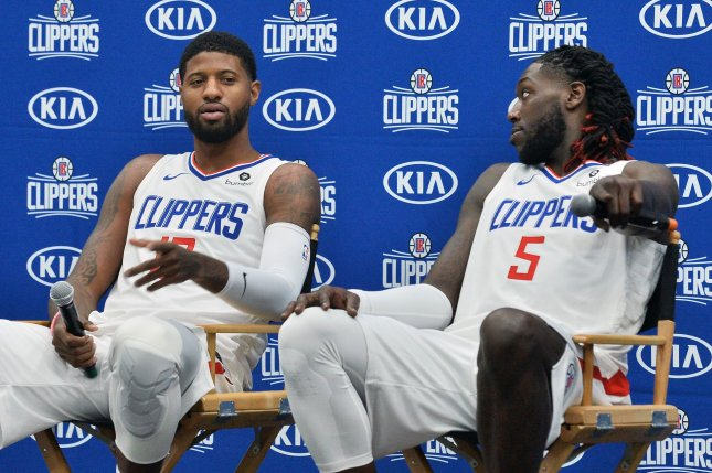 Los Angeles Clippers stars Paul George (L) and Montrezl Harrell (R) will team up for what is expected to be one of the best defenses in the league during the 2019-2020 NBA season. Photo by Jim Ruymen/UPI