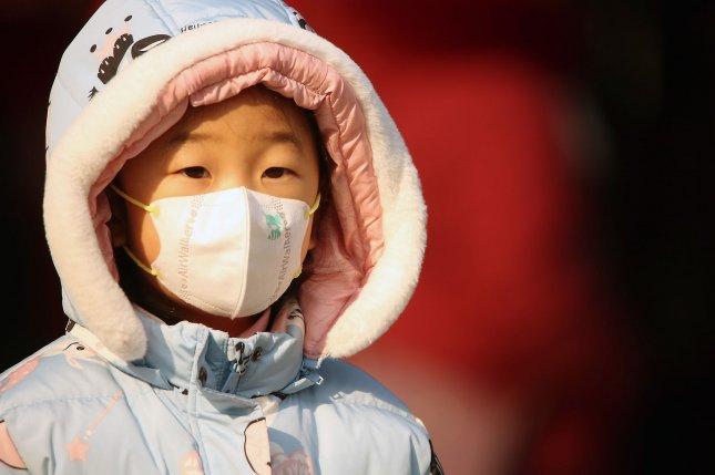 A Chinese citizen wears a protective respiratory mask in Beijing, China, on Wednesday to guard against the spread of a coronavirus. Photo by Stephen Shaver/UPI