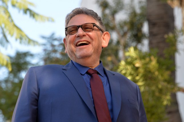 Lucian Grainge chairman and chief executive officer of Universal Music Group, reacts to comments by singer Lionel Richie during an unveiling ceremony honoring him with the 2,685th star on the Hollywood Walk of Fame on Thursday. Photo by Jim Ruymen/UPI