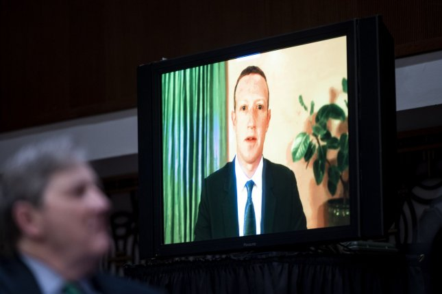 Facebook CEO Mark Zuckerberg appears on a television screen as he testifies remotely during a Senate hearing October 28 on potential reforms to  Section 230 of the Communications Decency Act. Pool Photo by Michael Reynolds/UPI