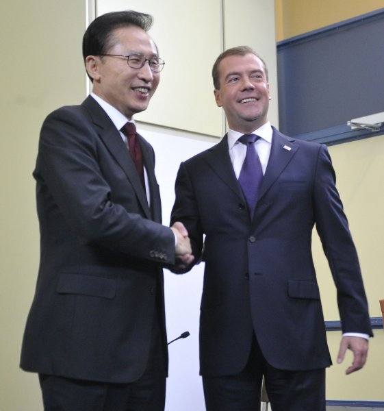 South Korean President Lee Myung-Bak (L) shakes hands with Russian President Dmitry Medvedev at a conference in Russia Sept. 10, 2010. UPI/Alex Volgin