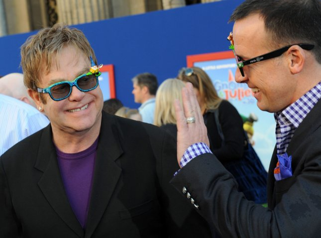 Musician and Exec. Producer Elton John (L) and his husband, producer David Furnish arrive for the premiere of the animated 3D comedy motion picture Gnomeo & Juliet at the El Capitan Theatre in the Hollywood section of Los Angeles on January 23, 2011. UPI/Jim Ruymen