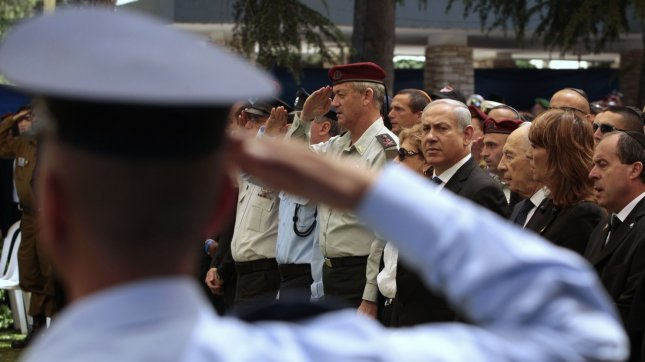 Israel's Chief of Staff Lieutenant-General Benny Gantz (6th R) salutes as he stands near Prime Minister Benjamin Netanyahu (4th R) during the annual Memorial Day ceremony commemorating fallen soldiers at Mount Herzl military cemetery in Jerusalem May 9, 2011. Israel on Monday marks Memorial Day to commemorate its fallen soldiers. UPI/Baz Ratner/Pool