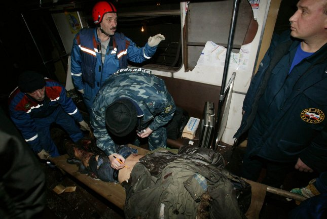 Russian emergency workers carry the body of a victim at Park Kultury metro station in Moscow on March 29, 2010. Two female suicide bombers killed at least 38 people and injured many on two Moscow metro trains in the morning rush hour on Monday. UPI/Alex Natin
