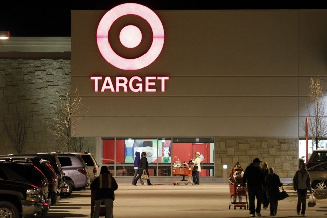 Shoppers leave a Target store in the early morning hours on November 26, 2010 in Waukesha, Wisconsin. Big box retailers opened as early as 12:01am in some cities on Black Friday as the holiday shopping season officially began. UPI/Brian Kersey