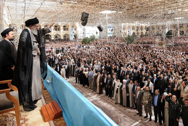 Iran's current supreme Leader Ayatollah Khamenei waves to his supporters at the 25th anniversary of the death of founder of Islamic Revolution, Ayatollah Khomeini, at his shrine in Tehran on June 4, 2014. UPI/Leader.ir/HO