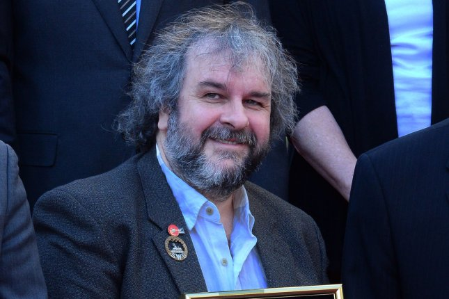 Director Peter Jackson holds a replica plaque during an unveiling ceremony honoring him with the 2,538th star on the Hollywood Walk of Fame in Los Angeles on December 8, 2014. UPI/Jim Ruymen