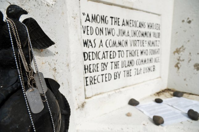 Military Dog Tags seen are left by visited soldiers to Mt.Suribachi on the island of Iwo To, Japan, on March 21, 2015. The island, famous as a WWII battleground, is administered as part of Tokyo, although 750 miles away. Photo by Keizo Mori/UPI