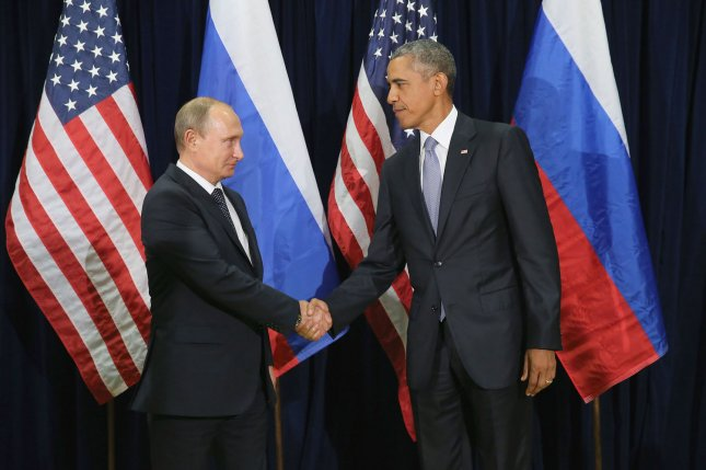 Russian President Vladimir Putin (L), nor any other Russian leader, are expected to attend this week's Nuclear Security Summit in Washington, D.C., because the Kremlin said there's been a lack of cooperation. President Barack Obama, pictured at left shaking hands with Putin in September, is expected to meet with the leaders of some 56 nations. File Photo by Chip Somodevilla/UPI