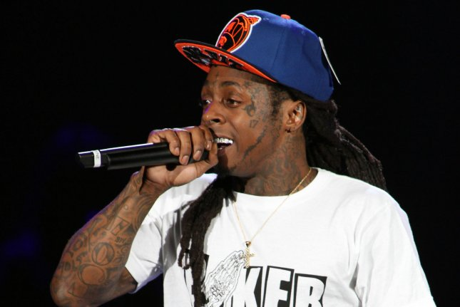 Lil Wayne performs in concert on his America's Most Wanted tour at the Cruzan Amphitheatre in West Palm Beach, Fla., in 2013. Wayne details an affair his girlfriend had with fellow rapper Drake in his upcoming memoir. File Photo by Michael Bush/UPI