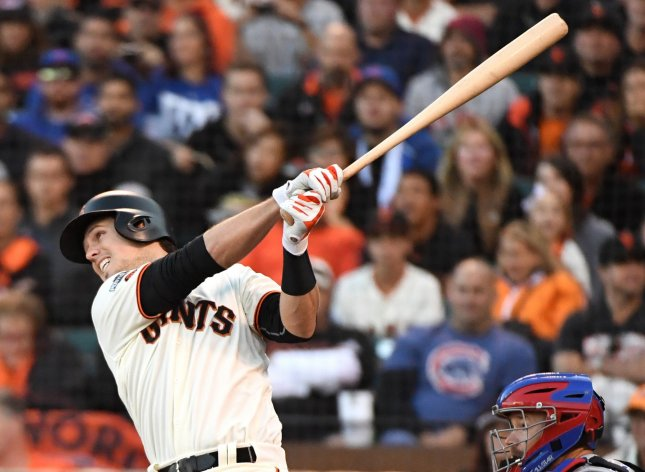 Buster Posey and the San Francisco Giants face the Oakland A's on Friday. Photo by Terry Schmitt/UPI