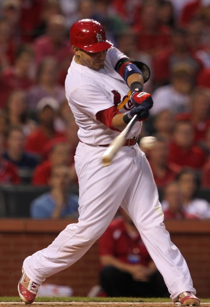 St. Louis Cardinals Yadier Molina connects for a two RBI triple in the sixth inning against the Chicago Cubs at Busch Stadium in St. Louis on May 14, 2012. UPI/Bill Greenblatt