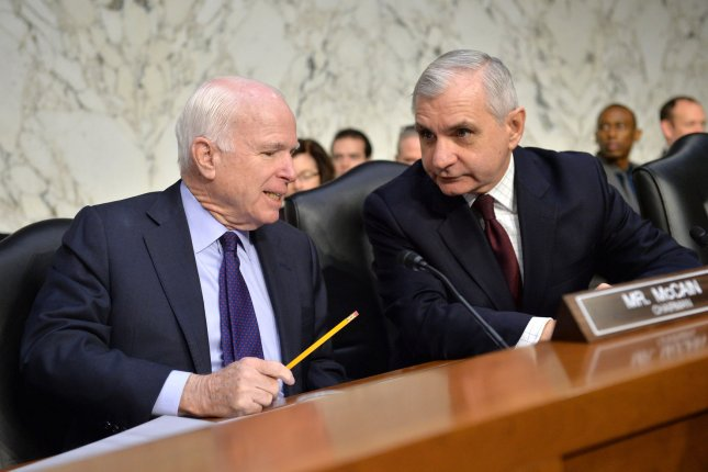 Senate Armed Services Committee Chairman John McCain (R-Ariz.) (L) and ranking member, Sen. Jack Reed (D-R.I.), shown in January, presented a defense bill Thursday that would eliminate the undersecretary for acquisition, technology and logistics. File photo by Kevin Dietsch/UPI