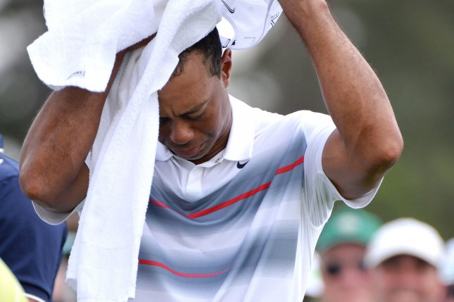Tiger Woods towels off on the first tee box in the first round the 2015 Masters Tournament at Augusta National Golf Club in Augusta, Georgia on April 9, 2015. Woods announced on his website that he will not play in the U.S. Open this week at Oakmont. Photo by Kevin Dietsch/UPI