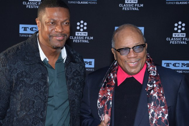 Quincy Jones (R) and Chris Tucker attend the 50th anniversary screening of In the Heat of the Night on April 6. Jones was awarded $9.42 million in a dispute with the estate of Michael Jackson. File Photo by Jim Ruymen/UPI