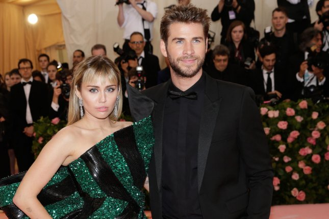 Liam Hemsworth (R) and Miley Cyrus. Hemsworth commented on his split from Cyrus on social media. File Photo by John Angelillo/UPI