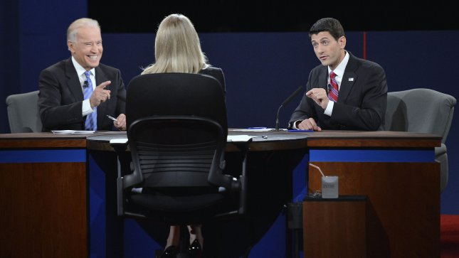 Vice-President Joe Biden smiles during Republican Vice-President nominee Paul Ryan's response to a question at the Vice-Presidential debate at Centre College on October 11, 2012 in Danville, Kentucky. UPI/Brian Kersey