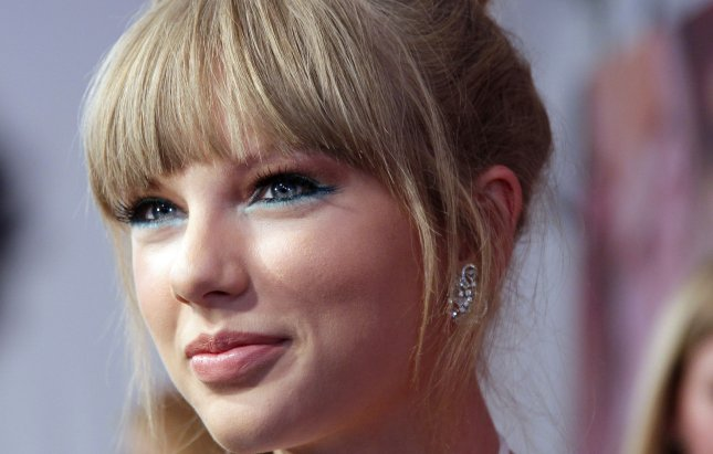 Taylor Swift arrives on the red carpet at the Fragrance Foundation Awards at Lincoln Center's Alice Tully Hall in New York City on June 12, 2013. UPI/John Angelillo