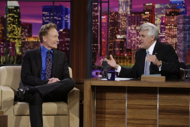 In this photo provided by NBC, Conan O'Brien (L) is interviewed by Jay Leno during Leno's final taping as host of The Tonight Show in Burbank, California on May 29, 2009. (UPI Photo/Paul Drinkwater)