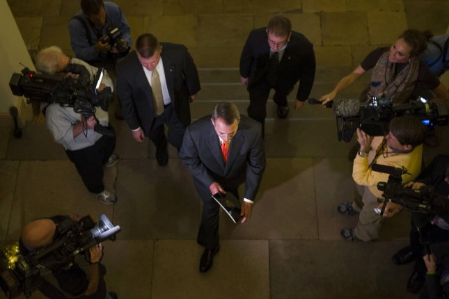 Speaker of the House John Boehner (R-OH) walks past a group of journalist as he arrives for the day at the U.S. Capitol on October 16, 2013 in Washington, D.C. The congress is working to pass a bipartisan agreement to end the government shutdown and reach an agreement on the debt limit. UPI/Kevin Dietsch