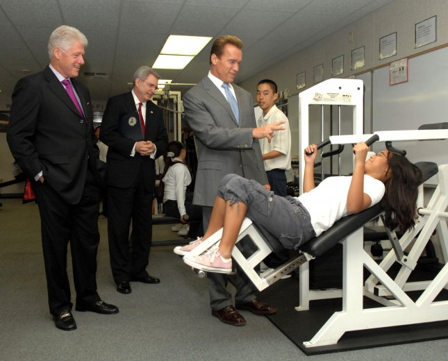 2011–12, 13% of U.S. adults have high cholesterol, unchanged 2009–10.Former president Bill Clinton (L) and California Gov. Arnold Schwarzenegger (R), co-leaders of the Alliance for a Healthier Generation, tour Columbia Middle School with Dr. Dan Jones (C), president of The American Heart Association. (UPI Photo/Jim Ruymen).