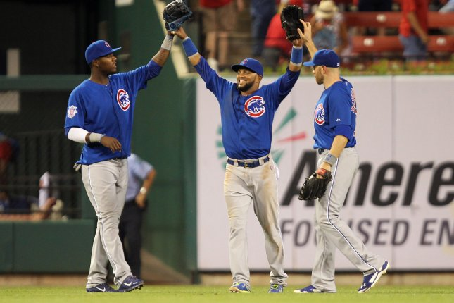Chicago Cubs (L TO R) Junior Lake, Emilio Bonifacio and Nate Schierholtz celebrate the third out and a 17-5 win over the St. Louis Cardinals at Busch Stadium in St. Louis on May 12, 2014. UPI/Bill Greenblatt