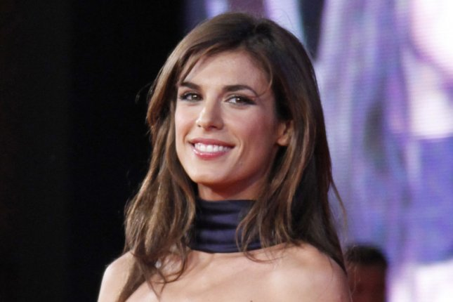 Elisabetta Canalis arrives on the red carpet before a screening of the film Up in the Air during the 4th Rome International Film Festival in Rome on October 17, 2009. UPI Photo/David Silpa