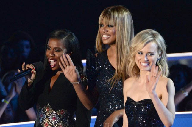 Orange is the New Black stars Uzo Aduba, Laverne Cox and Taylor Schilling are seen in this August 2014 UPI file photo. Their show earned a Golden Globe nomination for Best Comedy Series Thursday. Aduba and Schilling were also singled out for their stellar performances.