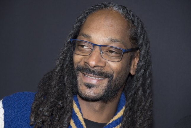 Snoop Dogg attends the premiere of the film Meet the Blacks held at the ArcLight Theater in Los Angeles on March 29, 2016. He has asked his fans to join him in boycotting History's Roots revival, saying he does not want to emphasize the abuse African Americans have been through, and wants to promote more inspiring stories from people of color. File Photo by Phil McCarten/UPI